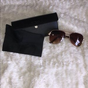 Guess sunglasses  with case and wipe.